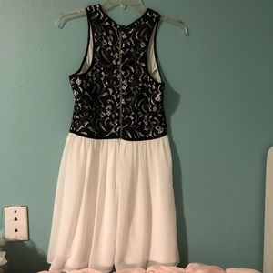 Black and white dress with floral design.